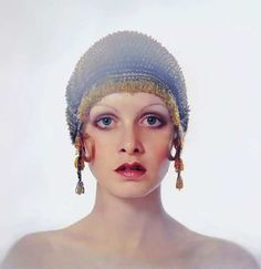 Twiggy in a flapper style hat