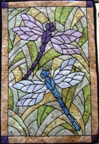 Dragonfly Garden in Patterns and Kits - A pattern by Three Swans offered on Quilters Treasure Web Site. When there click on the YouTube link for a demonstration of Quilters Treasure Stained Glass Technique