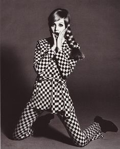 Twiggy in a checker suit. A check (or checker, Brit: chequer, checkerboard or  chequerboard) is a pattern consisting of crossed horizontal and vertical lines forming squares.Non to be confused with gingham because there are only two colors.
