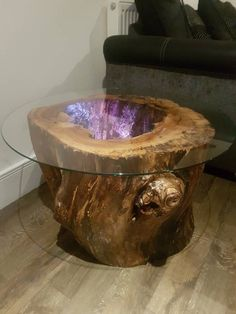 Glass top coffee/end table with hollow stump and colour changing remote led light. Glass top coffee/end table with hollow stump and colour changing remote led light.