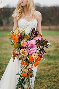 Colorful Flowers: Love the colors of the fall season? Have your florist create a dynamic bouquet full of yellows, oranges, and red for your wedding bouquet. This giant bouquet is an extreme design, with flowers cascading nearly down to the ground. If you like this type of bouquet, make sure to do a little weight-lifting before your wedding day!