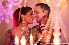 An Indian bride and groom choose a pink color palette for the decor of their wedding ceremony and reception. The bride dons colorful ensembles for both her ceremony and reception saris. Wedding Photography Poses, Wedding Poses, Wedding Groom, Wedding Couples, Bride Groom, Wedding Reception, Candid Photography, Wedding Ideas, Indian Wedding Planner