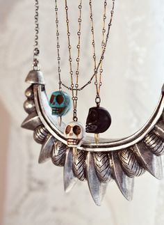 Skull necklaces and silver bib type necklace.... oraclejewellery (via beach-bliss)