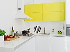 Fabulous hit of painted yellow in this all white kitchen.