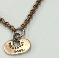 This is the Life Brass and Sterling Silver Key Tag by mLindvall, $71.00