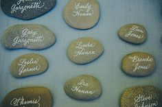 Calligraphy on rocks by Mo Seder, Photo by Lisa Lefringhouse.