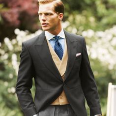 Slate morning suit, buff waistcoat, blue shirt and tie.