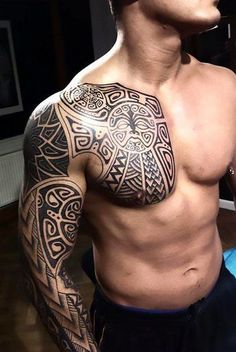 A badass tribal tattoo with Polynesian motives inked on from the man's chest to his arm. Style: Tribal. Color: Black. Tags: Cool, Badass