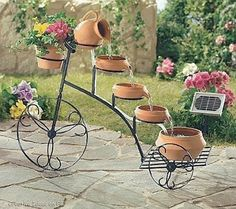 bicycle used for making a water fountain and garden decoration Uhles Van Winkle Myers Design Fonte, Water Fountain Design, Fountain Ideas, Garden Art, Home And Garden, Pot Jardin, Garden Fountains, Water Fountains, Fountain Garden