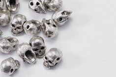 50pcs Mini Skull Beads in Silver Tone, Halloween Skull, Gothic Skull, Side Drilled Metal Beads #SD-S6926 by SuppliesDirect on Etsy https://www.etsy.com/listing/194269541/50pcs-mini-skull-beads-in-silver-tone