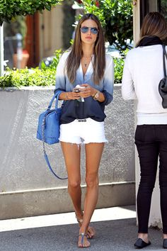 Alessandra Ambrosio highlights her tan in a pair of bright white cut-offs-- adding a summery ombre top with bag to match.