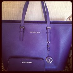 Beautiful purple Michael Kors purse and bag!