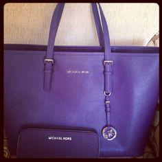 Beautiful purple Michael Kors purse and bag!