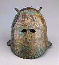 "Bronze Helmet  Greek, South Italy, 400 - 375 B.C.  The J. Paul Getty Museum  ""Three attachments on the top of the helmet originally held decoration, probably horsehair crests, feathers, or metal animal horns."