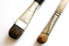 Paint drawer knobs with small paint brushes.