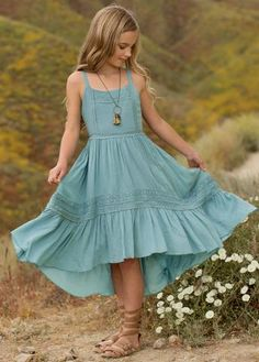 Twirl all Summer long in this beautiful, high-low maxi dress. Crochet lace trim accents the...