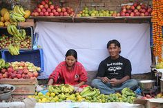 Joyous fruit harvesters and sellers. Beautiful.