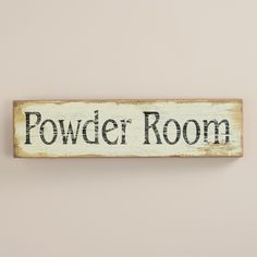 Our Powder Room Wall Art makes a charming addition to the bathroom wall or door. Crafted of wood, it features distressed black lettering and a whitewash finish for a vintage look.