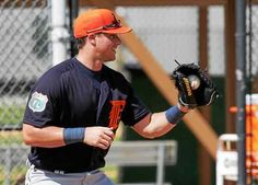 Detroit Tigers catcher James McCann goes through a drill during a spring training baseball workout, Monday, Feb. 22, 2016, in Lakeland, Fla. McCann is nearing a return from the ankle he sprained earlier this month.