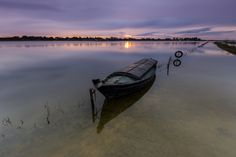 """Fourth picture of the series Canes & Mud. (This is the same day that the first photography of the serie, but just a few minutes after sunrise. Soon I will post new photos of both session.) Magical sunrise in this beautiful place that is the Albufera of Valencia. The image title is because during the photoshoot, surrounded by all this beauty, calm water, boat, reeds, mud, tranquility, flying birds ... every moment reminded me a lot to the great novel """"Cañas y Barro"""" of the great Valencian…"""