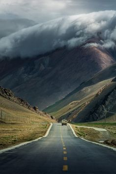 Landscape photography of mountains, clouds, and lonely road