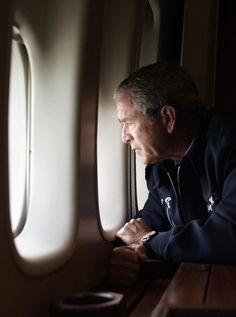 This Aug. 2005 file photo shows U. President George W. Bush looking out the window of Air Force One as he flies over New Orleans, Louisiana, surveying the damage left by Hurricane Katrina. Katrina Photo, American Presidents, Us Presidents, George W Bush Quotes, Bush Family, Louisiana History, Power Trip, Army Corps Of Engineers
