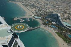 Tiger Woods Hitting Golf Balls on helipad of Burj Al Arab Sailboat Hotel in Debai, Arab emirates
