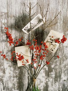 Use pretty autumn twigs to display family photos. More fall decor ideas: http://www.bhg.com/decorating/seasonal/fall/inspired-fall-decorating-ideas/?socsrc=bhgpin100212stemphotodisplay#page=12