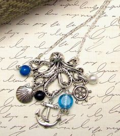 Octopus Necklace Kraken Charm Necklace Antique Silver Pendant Ocean Beach Necklace Beach Jewelry with 22 inch Silver Plated Chain. $21.00, via Etsy.