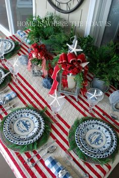 A Coastal Christmas Table....love the quilt as tablecloth and galvanized pails holding items (PS you can find the blue crab dinnerware at Caron's Beach House)