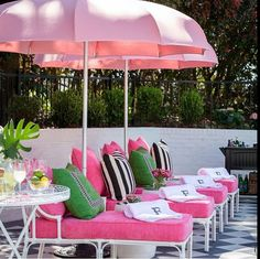 Hot pink (fuchsia) with green and black accents. Outdoor living classic.