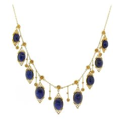 Egyptian Revival Lapis Lazuli Gold Scarab Necklace | From a unique collection of vintage drop necklaces at https://www.1stdibs.com/jewelry/necklaces/drop-necklaces/