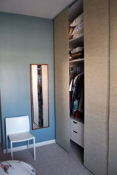 and fabric curtain combo in a previous apartment to hide an exposed closet, but it was much narrower and not as tall. Our 11.5' wardrobe wall also has a window in the middle which we did not want to block out. We decided on the triple-rail Kvartal system with Anno Sanela flat panel curt