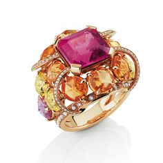 """A ring combines rubellite with rose, orange and yellow sapphires [plus the tiny diamonds that line the 18K pink gold edging of the ring]. """"Paratii Ring from Fine Jewelry Privee Collection; Mellerio DitsMeller"""""""
