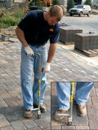 PaveTech Paver Adjuster. Used to correct paver alignment.