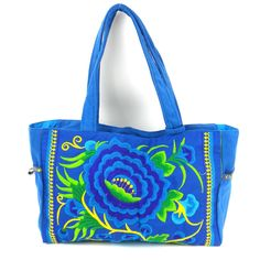 Embroidered shoulder bag 9 inches tall 15 inches wide and 4.5 inches deep, featuring hill tribe embroidery and trim. Lined with colorful easy wipe-clean lining, includes a Zipped main pocket with insi