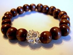 Check out this item in my Etsy shop https://www.etsy.com/listing/50222395/wood-and-rhinestone-bracelet