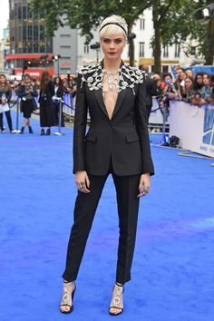 Cara Delevingne arrives at the Valerian premiere in London wearing a custom Burberry black tailored suit with a crystal capelet inspired by British vintage jewellery