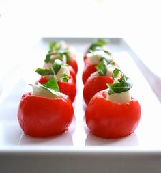 Cherry tomato appetizers... I would drizzle these with balsamic glaze for extra goodness!