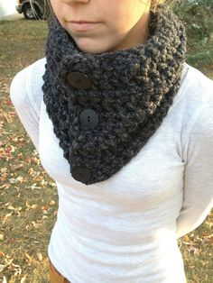 Hand made Buttoned Cowl scarf is made of a blend of soft Lambs Wool and Acrylic yarn. It is a soft chunky yarn that is Charcoal color. Also can