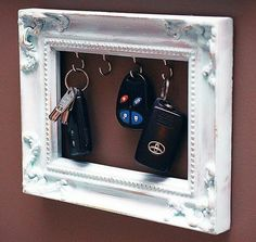 Take an old picture frame and hang it on your wall, its a cute way to reuse those frames.