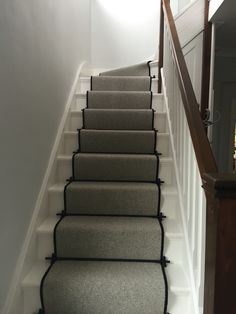 Lakeland herdwick carpet 3 ply wool (Windermere) stair runner with black binding. Premier stair rods with Lancaster finials in black. Walls are Blackened by Farrow and Ball