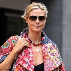 Protecting herself: Heidi Klum, 40, wears the coveted necklace. It is thought to fend off the bad luck caused by the 'evil eye'