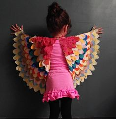 I saw a kid at my school with a costume very similar to this and fell in love with it!  She also had a matching skirt that was made just like the wings.