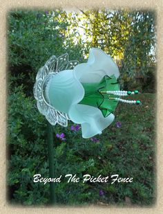 frosted white and green with stamins trumpet flower