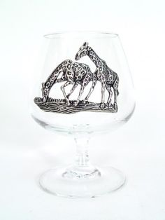Giraffe Brandy Glass  $30.00. Beautiful drinks deserve beautiful glassware, and your finest brandy or bourbon will open up magnificently in this elegant pewter giraffe snifter! In fact, anything you put in this glass will surely taste delicious.  The wide base and narrow top are accented with intricate pewter from South Africa. Add a lion, leopard and elephant and make a complete set!