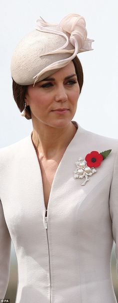 The Duchess wore a poppy and a diamond and pearl leaf brooch
