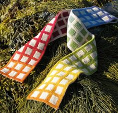 I would love to make this amazing scarf. It's double knit (I have never done this) and reminds me of watercolor paint tray Paintbox scarf by Lucy Neatby Designs