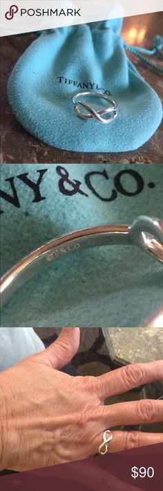 Tiffany and Co infinity ring Just had cleaned at Tiffany! AMAZING condition barley wore. Size 6! Tiffany & Co. Jewelry Rings