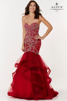 Alyce Paris 6746 is a mermaid gown with a tulle ruffled skirt, embellished bodice and strapless sweetheart neckline.